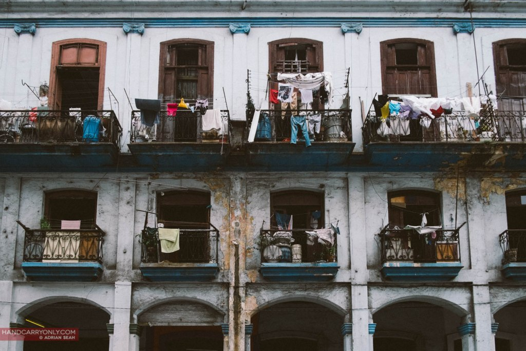 old buildings with clothes hanging in havana cuba