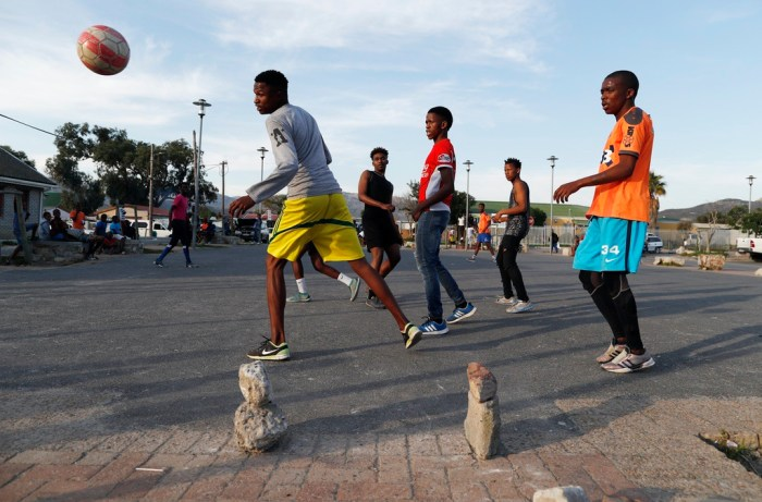 epa06803057 Men play football in a park in Masiphumelele, Cape Town, South Africa 12 June 2018. With five African teams at the FIFA World Cup 2018 excitement mounts amongst football fans on the African continent passionate about the sport ahead of the FIFA World Cup 2018 taking place from 14 June until 15 July 2018.  EPA/NIC BOTHMA