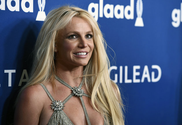 "FILE - This April 12, 2018 file photo shows Britney Spears at the 29th annual GLAAD Media Awards in Beverly Hills, Calif. Spears has decided to focus on self-care as she goes through a rough stretch. She posted an image on Instagram Wednesday with the words, ""Fall in love with taking care of yourself. Mind. Body. Spirit."" People magazine reports that worries for her father and the need to help take care of him after a life-threatening colon rupture last year have continued to take a toll on the pop star. (Photo by Chris Pizzello/Invision/AP, File)"