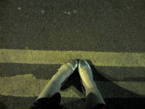 feet, on the ground