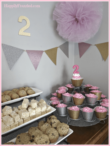 Add glitter to your party decor by using scrap book paper to make a custom banner | HappilyFrazzled.com