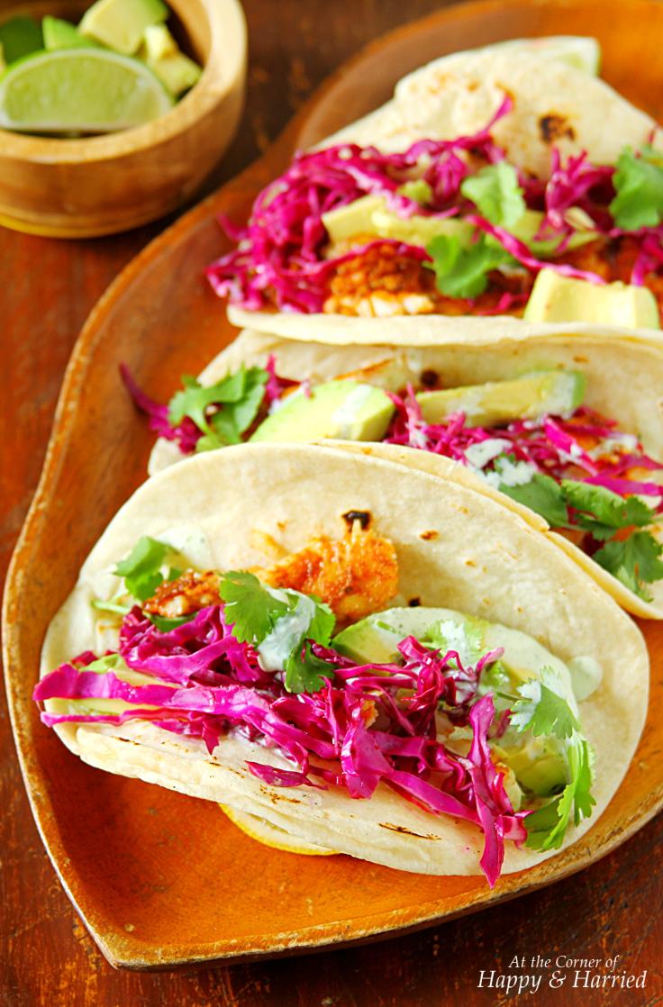 Fish tacos with cabbage slaw yogurt cilantro crema for Spicy fish tacos