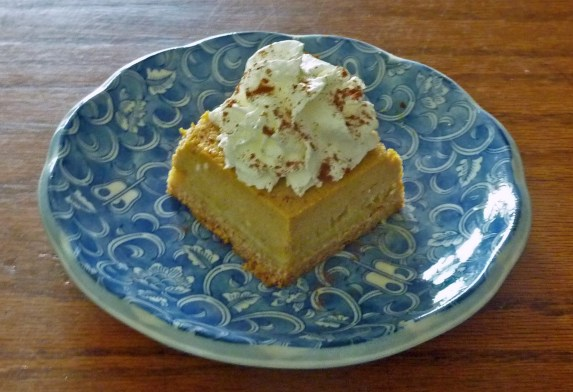 Pumpkin gooey butter cake with whipped cream