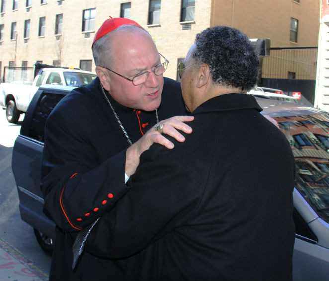 THE Cardinal Timothy Dolan embracing a friend