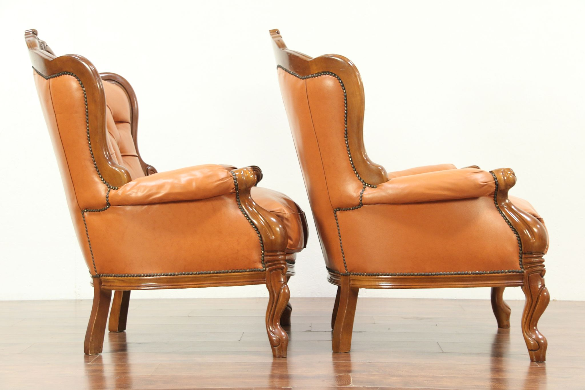 Sold Pair Of Carved Fruitwood Vintage Wing Back Chairs