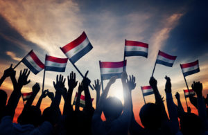 Silhouettes of People Waving the Flag of Iraq