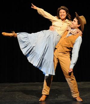 2 actors dancing on stage