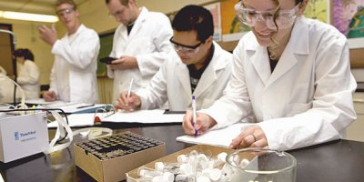 Four pharmacy students in a lab