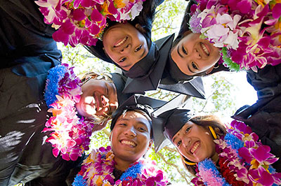 Group of students in graduation robes and leis