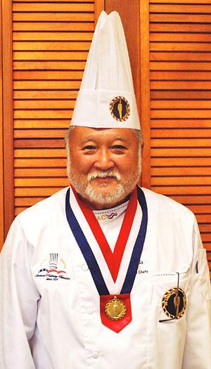 Head shot of Allan Okuda in chef uniform