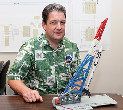 man with rocket model