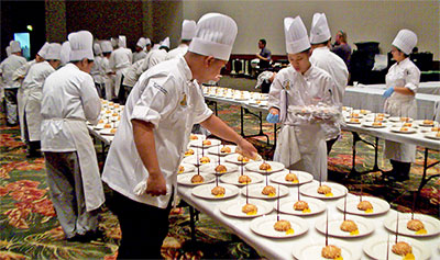 culinary students fixing food