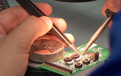 close up of engineer working on circuit board
