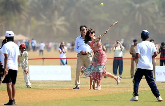 Kate Middleton shows off her sporty side as she plays cricket in India