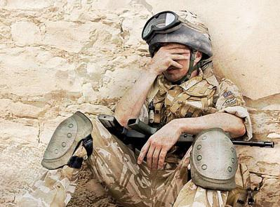 soldier covering his face