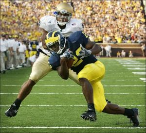 Courtney Watson tackles Michigan tailback Chris Perry.  (ZAPOTOSKY / TOLEDO BLADE)