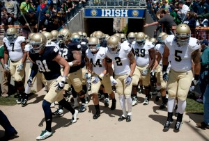 The Fighting Irish take the field for the Notre Dame Blue Gold game on Saturday, April 21, 2012, at Notre Dame. (James Brosher/South Bend Tribune)