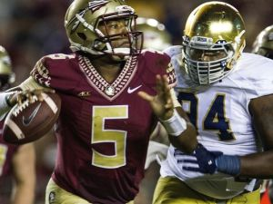 Notre Dame lineman Jarron Jones, right, chases Florida State quarterback Jameis Winson during the second half. (Photo: Mark Wallheiser , Associated Press ).