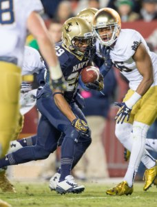 Nov 1, 2014; Navy Midshipmen running back Geoffrey Whiteside (29) runs for a touchdown in front of Notre Dame Fighting Irish cornerback Cole Luke (36) in the third quarter at FedEx Field. Mandatory Credit: Matt Cashore-USA TODAY Sports