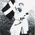 Laredo women Leonor V. Magnon and Jovita Idar pose in front of the flag of their organization La Cruz Blanca, which helped wounded soldiers during the Mexican Revolution