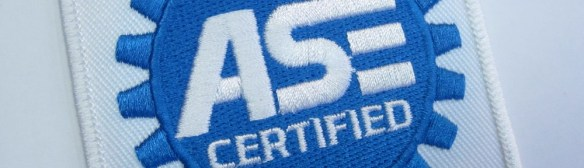 ASE logo on a shirt patch