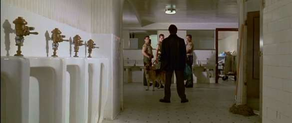 Reservoir dogs bathroom cops scene 585x248 Six of the Best Tarantino Scenes