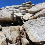 Looking up at the rock scramble on the rightmost route