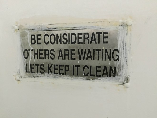 Words to live by in a restroom in New Delhi