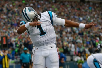SEATTLE, WA - OCTOBER 18:  Quarterback Cam Newton #1 of the Carolina Panthers celebrates after scoring a touchdown against the Seattle Seahawks at CenturyLink Field on October 18, 2015 in Seattle, Washington.  (Photo by Otto Greule Jr/Getty Images) ORG XMIT: 570176333 ORIG FILE ID: 493267298