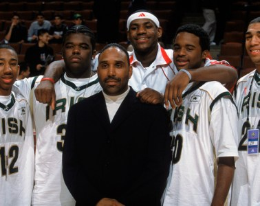 CHICAGO - MARCH 31:  LeBron James #23 of Team West poses for a photo with St. Vincent-St. Mary's teammates during the EA Sports Roundball Classic game against Team East at United Center on March 31, 2003 in Chicago, Illinois. Team West won 120-119.  NOTE TO USER: User expressly acknowledges and agrees that, by downloading and/or using this Photograph, User is consenting to the terms and conditions of the Getty Images License Agreement. Mandatory copyright notice:  Copyright 2003 NBAE (Photo by Garrett Ellwood/NBAE via Getty Images)