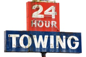 24-hour towing sign