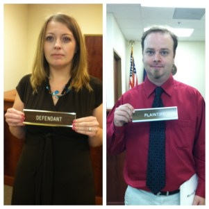 donna and kevin in courtroom before elopment having fun with plaintiff and defendent plaques