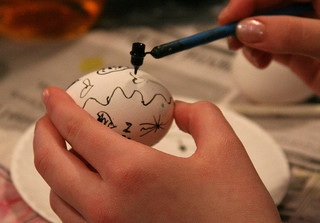 Ukrainian egg being painted with wax