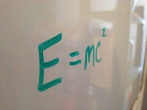 e equals m c squared on marker board