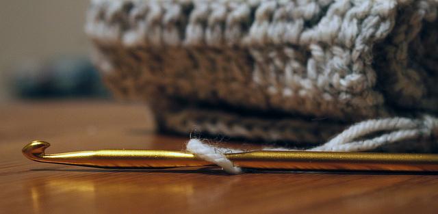 crocheting needle and yarn