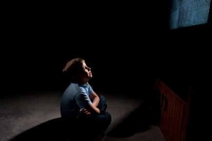 boy in front of tv