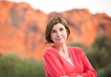 Jeanne Lyet Gassman with red rock mountains in back