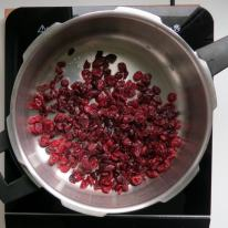 Add dried cranberries and lemon to the pressure cooker.