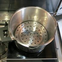 Add water and steamer basket/rack to base of cooker.