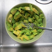 Mash the guacamole cubes with a fork.