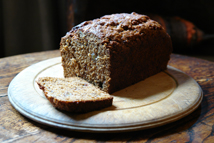 sliced banana ginger parkin on a vintage wooden chopping board
