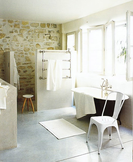 Bathroom with a stone wall. image © Frederic Vasseur