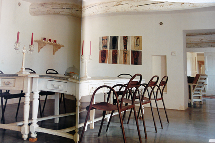 "double page spread showing whitewashed dining table with metal bistro-type chairs from ""The Way We Live In the Country"" by Stafford Cliff & Gilles de Chabaneix"