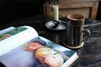 "photo of an old man holding a large pumpkin from ""The Way We Live In the Country"" by Stafford Cliff & Gilles de Chabaneix with vintage Briglin mug and antique metal candleholder"