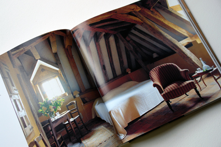 "attic bedroom with exposed rafters from ""The Way We Live In the Country"" by Stafford Cliff & Gilles de Chabaneix"