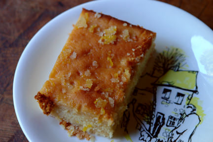 slice of lemon drizzle cake on a vintage plate