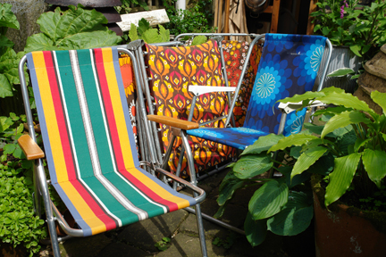 collection of colourful vintage garden and camping chairs
