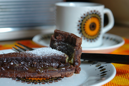 slice of chocolate and salted caramel tart on vintage 'Aztec' plate with matching cup &amp; saucer