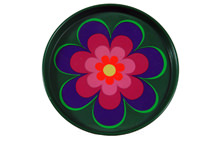 vintage 1960s/70s tin coaster with pink, purple and yellow flower on a dark green background
