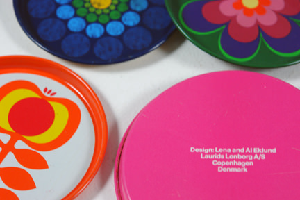 selection of vintage 1960s/70s patterned tin coasters